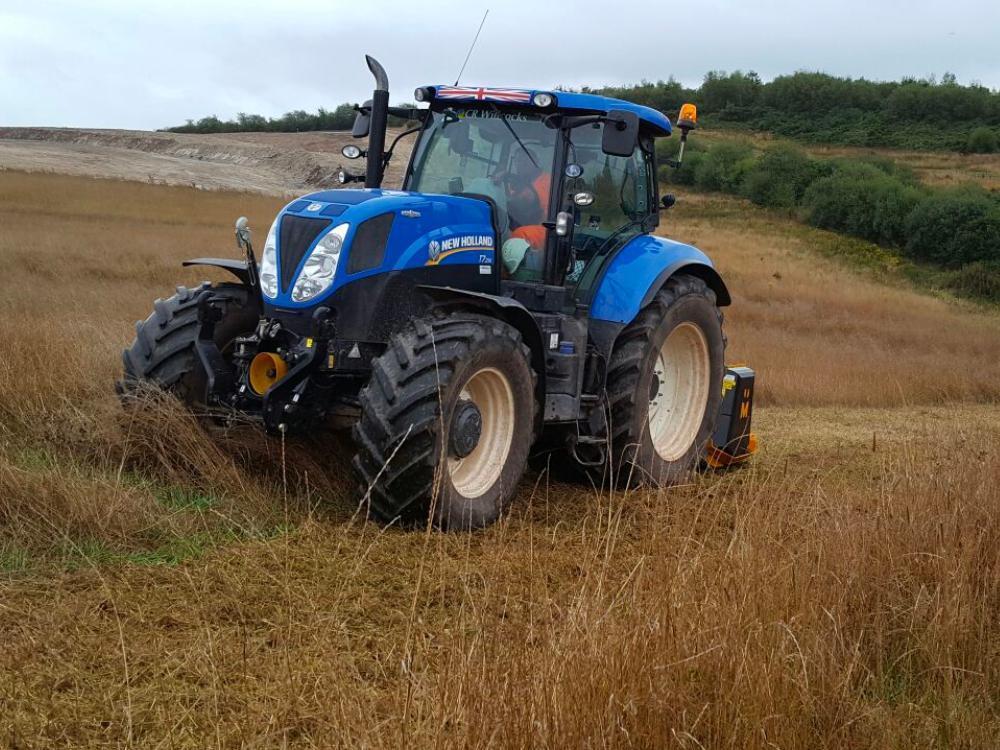 Vallance bllue tractor cutting grass