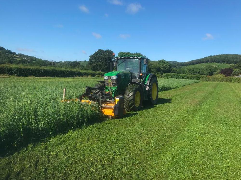Vallance green tractor cutting grass